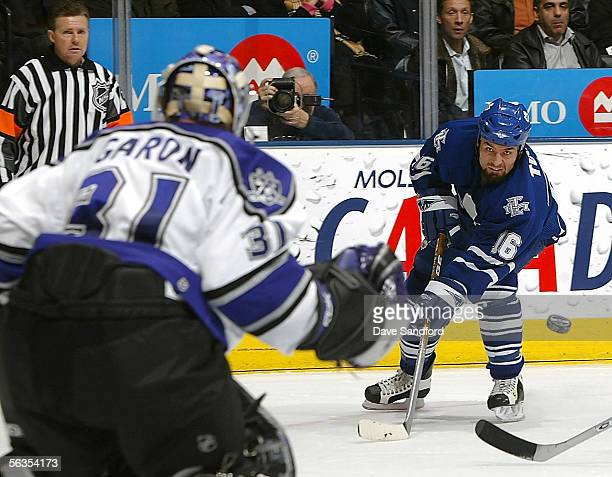 Darcy Tucker of the Toronto Maple Leafs takes a shot on Mathiew Garon of the Los Angeles Kings on December 6 2005 at the Air Canada Centre in Toronto...