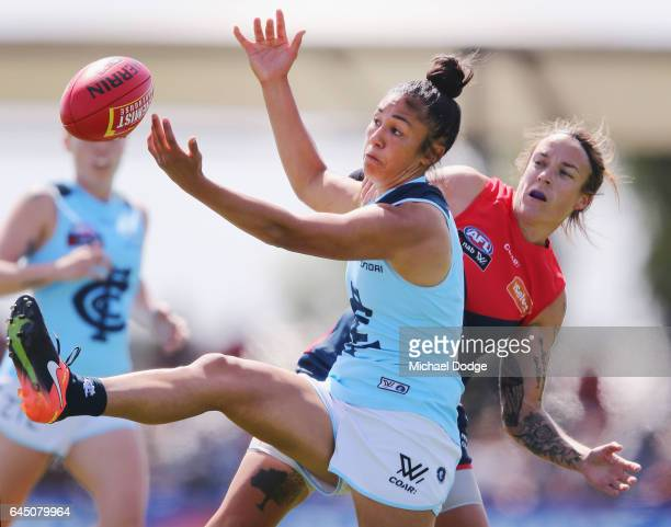 Darcy Vescio of the Blues and Mia RaeClifford of the Demons compete for the ball during the round four Women's AFL match between the Melbourne Demons...