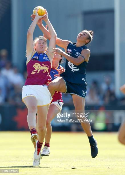 Darcy Vescio of the Blues and Tahlia Randall of the Lions compete for the ball during the 2017 AFLW Round 07 match between the Carlton Blues and the...