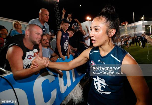 Darcy Vescio of the Blues celebrates with fans during the 2017 AFLW Round 01 match between the Carlton Blues and the Collingwood Magpies at Ikon Park...