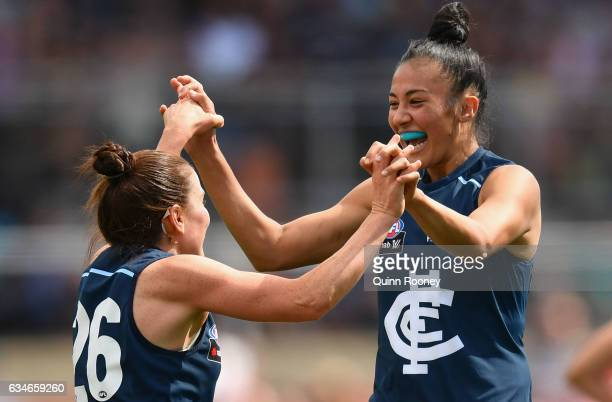 Darcy Vescio of the Blues is congratulated by Shae Audley of the Blues after kicking a goal during the round two AFL Women's match between the...
