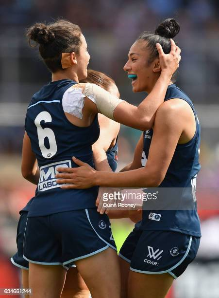 Darcy Vescio of the Blues is congratulated by team mates after kicking a goal during the round two AFL Women's match between the Carlton Blues and...