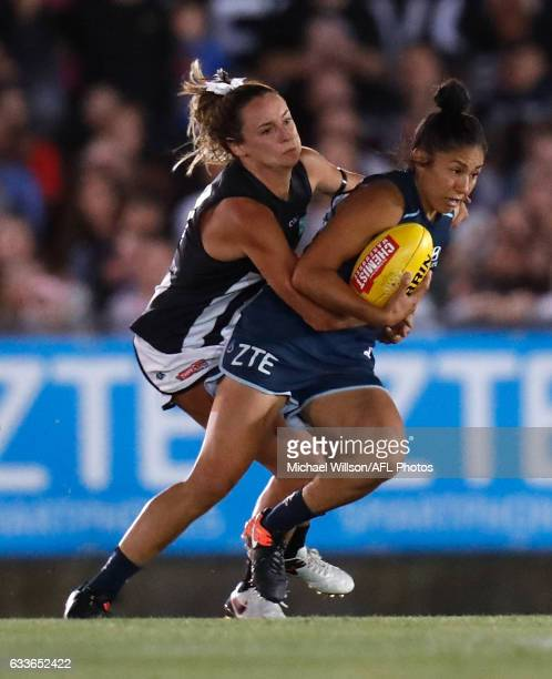 Darcy Vescio of the Blues is tackled by Cecilia McIntosh of the Magpies during the 2017 AFLW Round 01 match between the Carlton Blues and the...