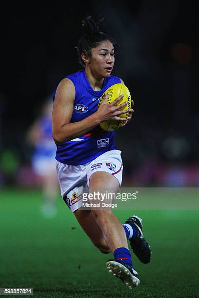 Darcy Vescio of the Bulldogs runs with the ball during the AFL Women's Exhibition Match between the Western Bulldogs and the Melbourne Demons at...