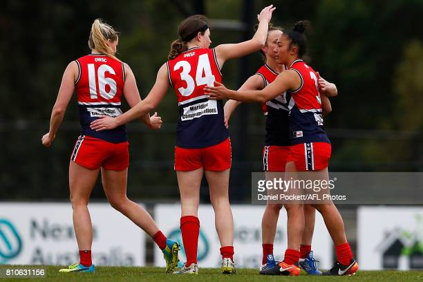 Darcy Vescio of the Falcons is congratulated after kicking a goal during the VFL Women's match between Cranbourne and Darebin at Casey Fields on July...