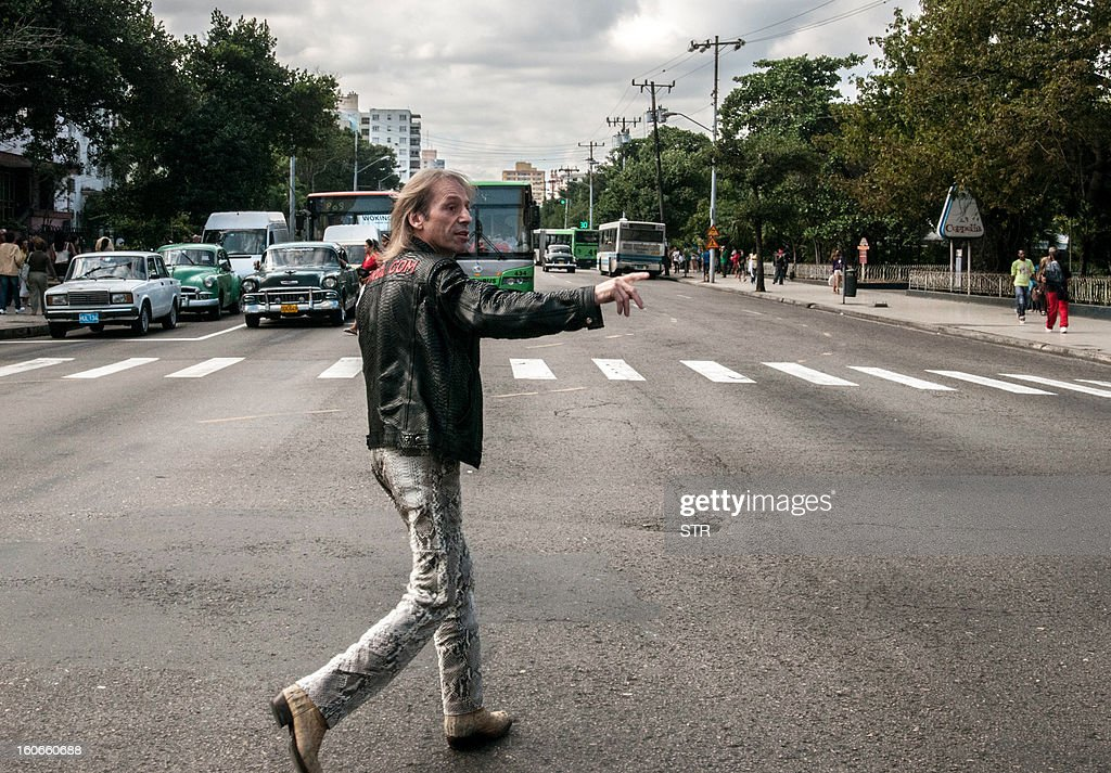Daredevil French climber Alain Robert, known as the French Spiderman, heads to the Habana Libre hotel, on February 4, 2013, in Havana, before climbing 22 floors (around 70 meters) of the hotel in 28 minutes.