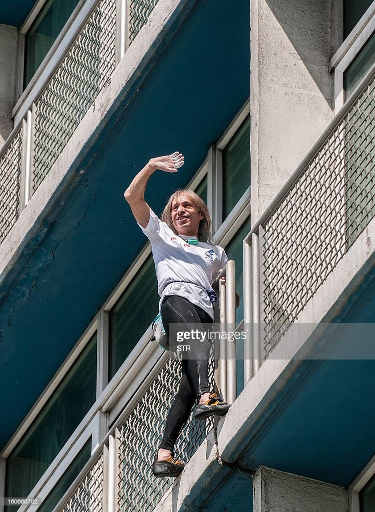 Daredevil French climber Alain Robert, known as the French Spiderman, waves while climbing the Habana Libre hotel, on February 4, 2013, in Havana. Robert climbed the 22 floors (around 70 meters) of the hotel in 28 minutes. Robert has climbed more than 100 of the world's tallest buildings, including the 828-metre Burj Khalifa in Dubai, Petronas Twin Towers in Kuala Lumpur, Sears Tower in the US city of Chicago and the 88-storey Jin Mao Building in Shanghai, China.