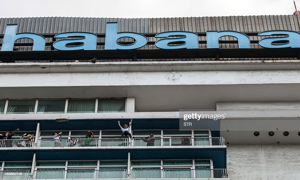 Daredevil French climber Alain Robert, known as the French Spiderman, celebrates after climbing the Habana Libre hotel, on February 4, 2013, in Havana. Robert climbed the 22 floors (around 70 meters) of the hotel in 28 minutes. Robert has climbed more than 100 of the world's tallest buildings, including the 828-metre Burj Khalifa in Dubai, Petronas Twin Towers in Kuala Lumpur, Sears Tower in the US city of Chicago and the 88-storey Jin Mao Building in Shanghai, China.