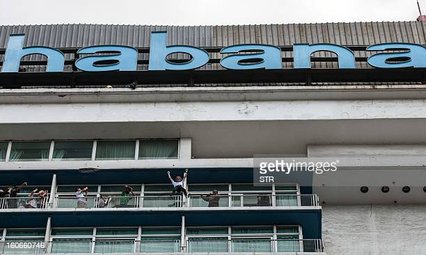 Daredevil French climber Alain Robert known as the French Spiderman celebrates after climbing the Habana Libre hotel on February 4 in Havana Robert...
