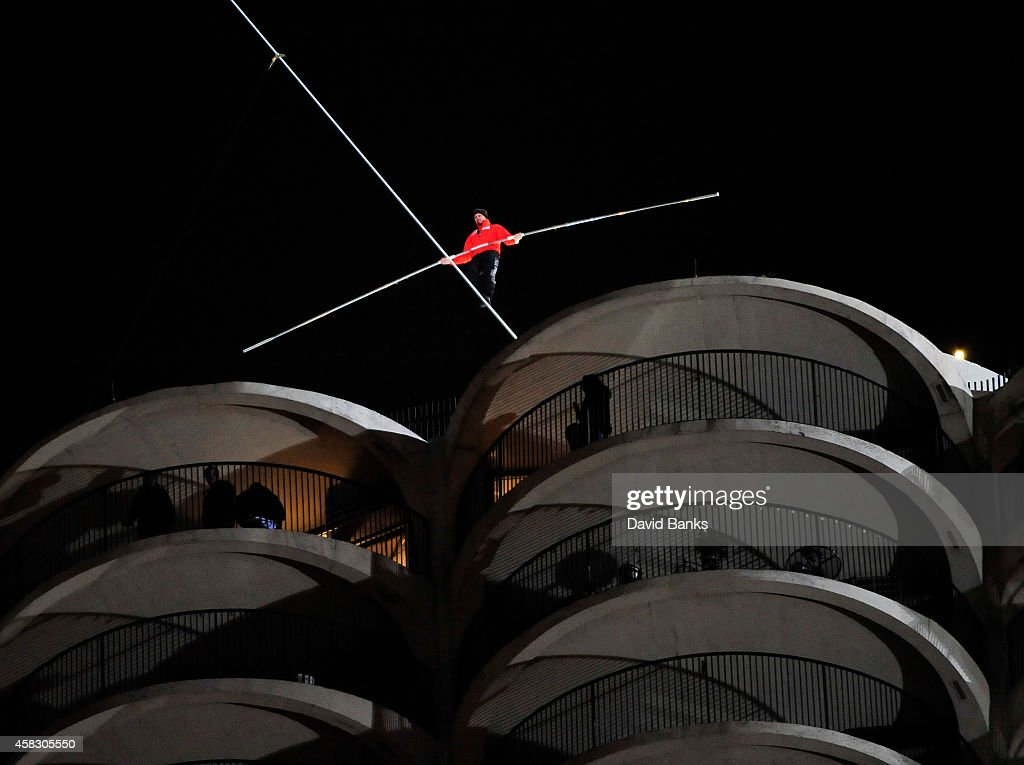 Daredevil <a gi-track='captionPersonalityLinkClicked' href=/galleries/search?phrase=Nik+Wallenda&family=editorial&specificpeople=7696638 ng-click='$event.stopPropagation()'>Nik Wallenda</a> walks a tightrope between buildings on November 2, 2014 in Chicago, Illinois. Wallenda has performed numerous high-wire feats that include being the first person to cross Niagra Falls on a tightrope.
