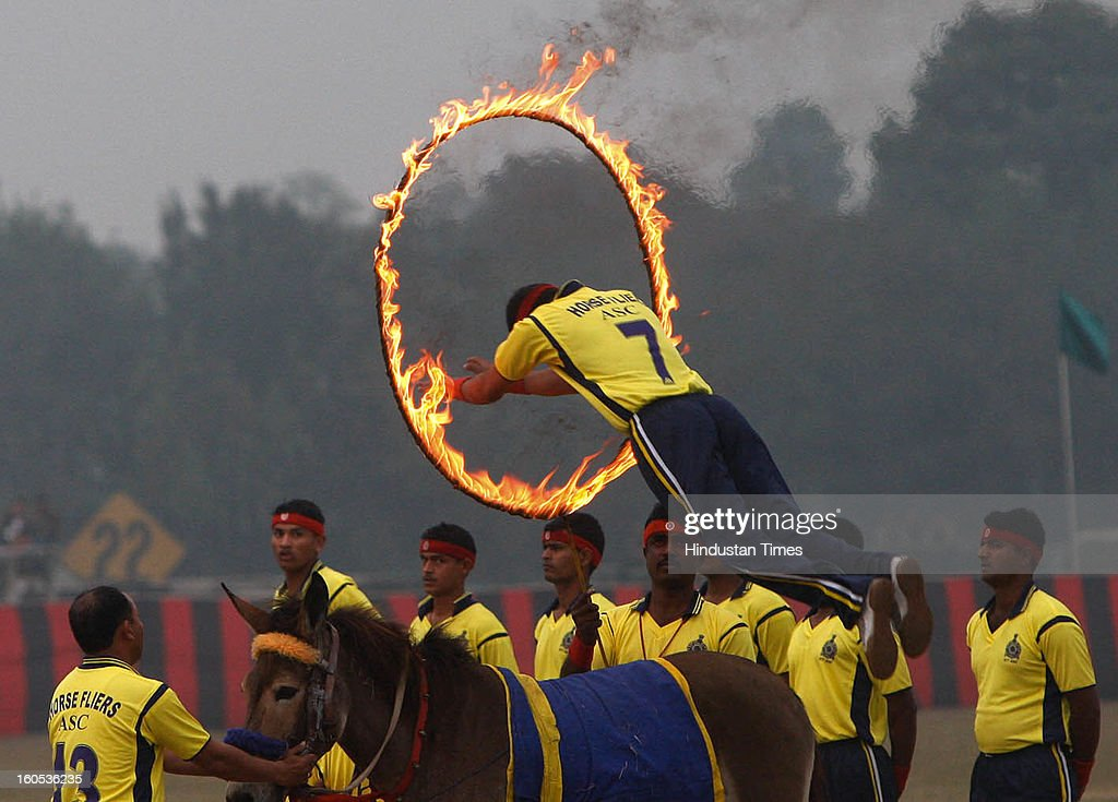 Daredevil of India Army jumps through fires showing his skills during 'Army Equipment Display and Military Tattoo' at Army Polo Ground, Race Course on February 2, 2013 in Kolkata, India.