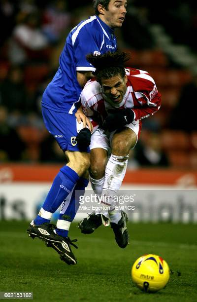 Darel Russell Stoke City and Kevin McNaughton Cardiff City battle for the ball