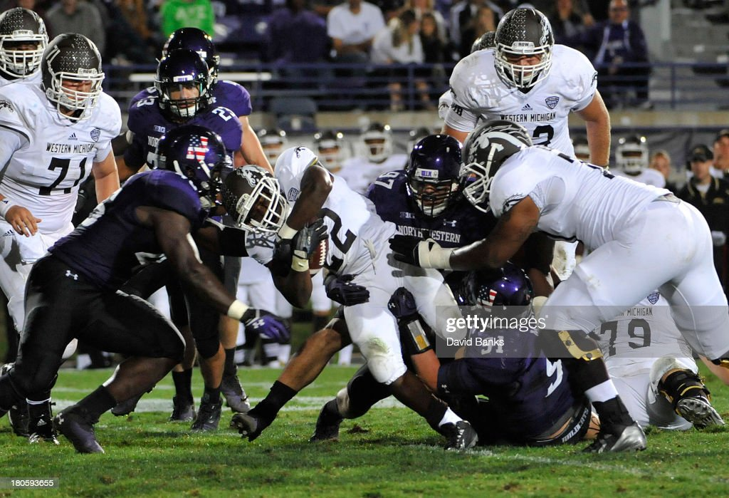 Dareyon Chance #22 of the Western Michigan Broncos is tackled by Sean McEvilly #91 of the Northwestern Wildcats during the fourth quarter on September 14, 2013 at Ryan Field in Evanston, Illinois. The Northwestern Wildcats defeated the Western Michigan Broncos 38-17.