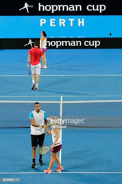 Daria Gavrilova and Nick Krygios of Australia Green celebrate winning a point in the mixed doubles match between Carline Garcia and Kenny De Schepper...