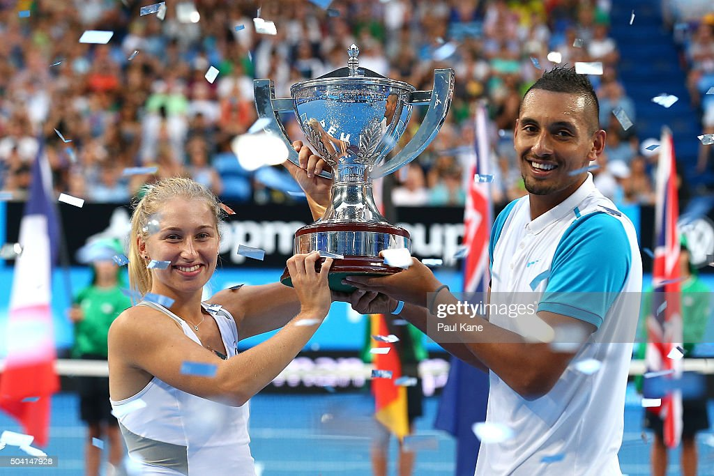 <a gi-track='captionPersonalityLinkClicked' href=/galleries/search?phrase=Daria+Gavrilova&family=editorial&specificpeople=5906023 ng-click='$event.stopPropagation()'>Daria Gavrilova</a> and <a gi-track='captionPersonalityLinkClicked' href=/galleries/search?phrase=Nick+Kyrgios&family=editorial&specificpeople=6705178 ng-click='$event.stopPropagation()'>Nick Kyrgios</a> of Australia Green pose with the Hopman Cup after winning the final against Elina Svitolina and Alexandr Dolgopolov of the Ukraine during day seven of the 2016 Hopman Cup at Perth Arena on January 9, 2016 in Perth, Australia.
