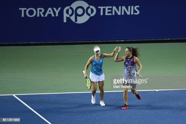 Daria Gavrilova of Australia and Daria Kasatkina of Russia celebrate in their doubles semi final match against Makoto Ninomiya of Japan and Renata...