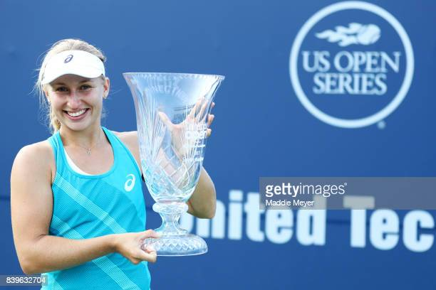 Daria Gavrilova of Australia celebrates with the winners trophy after defeating Dominika Cibulkova of Slovakia to win the Connecticut Open at...
