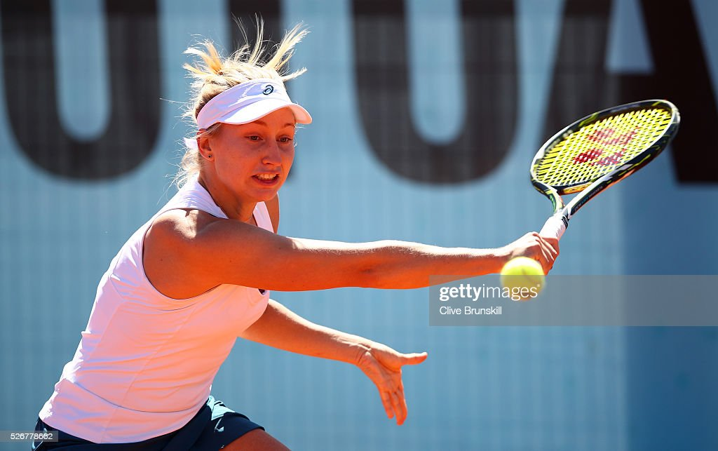 Daria Gavrilova of Australia plays a backhand against Heather Watson of Great Britain in their first round match during day two of the Mutua Madrid Open tennis tournament at the Caja Magica on May 01, 2016 in Madrid,Spain