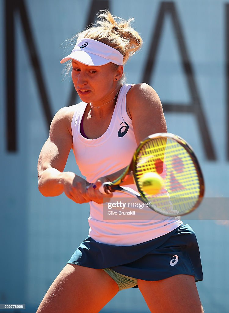 <a gi-track='captionPersonalityLinkClicked' href=/galleries/search?phrase=Daria+Gavrilova&family=editorial&specificpeople=5906023 ng-click='$event.stopPropagation()'>Daria Gavrilova</a> of Australia plays a backhand against Heather Watson of Great Britain in their first round match during day two of the Mutua Madrid Open tennis tournament at the Caja Magica on May 01, 2016 in Madrid,Spain