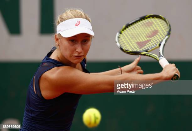 Daria Gavrilova of Australia plays a backhand during the ladies singles first round match against Elise Mertens of Belgium on day two of the 2017...