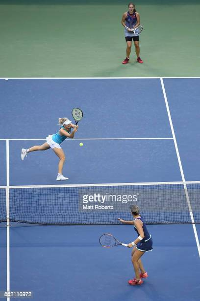 Daria Gavrilova of Australia plays a backhand with her doubles partner Daria Kasatkina of Russia against Andreja Klepac of Slovenia and Maria Jose...