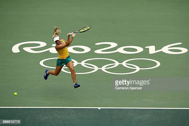 Daria Gavrilova of Australia plays a forehand against Serena Williams of the United States in their first round match on Day 2 of the Rio 2016...