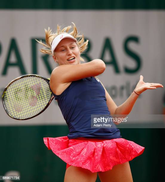 Daria Gavrilova of Australia plays a forehand during the ladies singles first round match against Elise Mertens of Belgium on day two of the 2017...