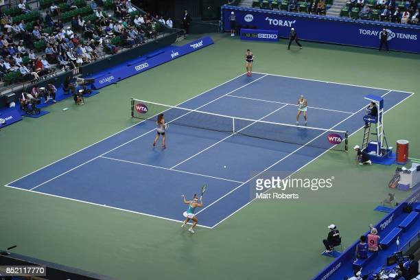 Daria Gavrilova of Australia plays a forehand with her doubles partner Daria Kasatkina of Russia against Andreja Klepac of Slovenia and Maria Jose...