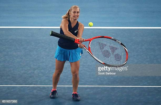 Daria Gavrilova of Australia plays tennis with an extra large racquet at the fifth annual Kids Tennis Day ahead of the 2017 Australian Open at...