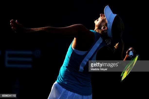 Daria Gavrilova of Australia serves to Dominika Cibulkova of Slovakia to win the Connecticut Open at Connecticut Tennis Center at Yale on August 26...