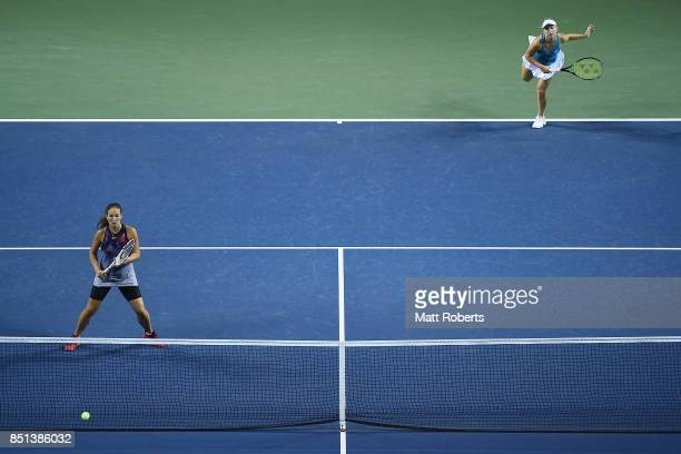 Daria Gavrilova of Australia serves with partner Daria Kasatkina of Russia in their doubles semi final match against Makoto Ninomiya of Japan and...