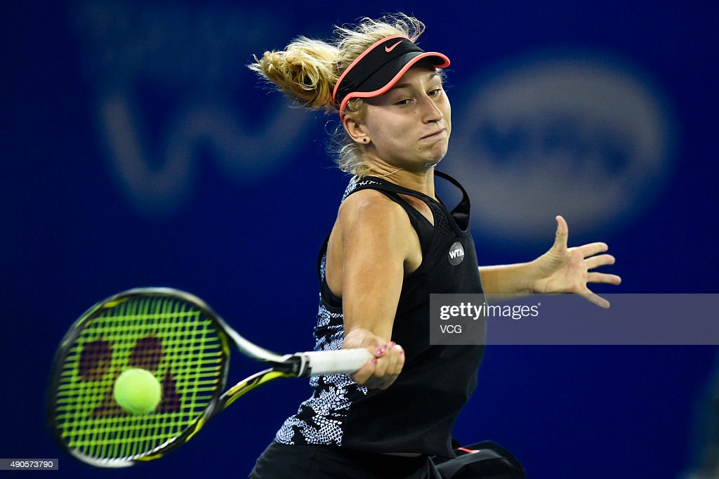 Daria Gavrilova of Russia returns a shot against Petra Kvitova of the Czech Republic during day three of the 2015 Wuhan Open at Optics Vally International Tennis Center on September 29, 2015 in Wuhan, China.