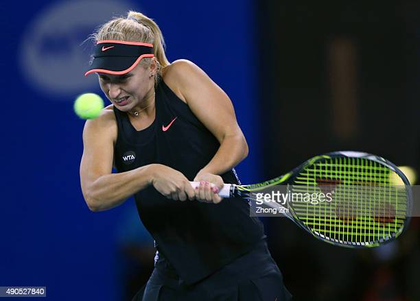 Daria Gavrilova of Russia returns a shot during the match against Petra Kvitova of Czech Republic on Day 3 of 2015 Dongfeng Motor Wuhan Open at...