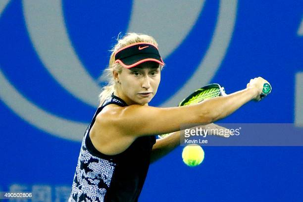 Daria Gavrilova of Russia returns a shot to Petra Kvitova of Czech Republic during her match in day 3 of 2015 Dongfeng Motor Wuhan Open at Optics...
