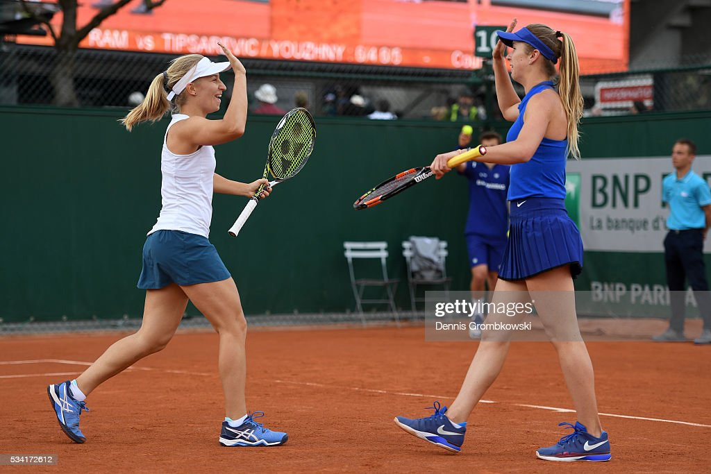 Daria Gavriolva of Australia high fives Elina Svitolina of Ukraine during the Women's Double first round match against Gabriela Dabrowski of Canada and Maria Jose Martinez Sanchez of Spain on day four of the 2016 French Open at Roland Garros on May 25, 2016 in Paris, France.