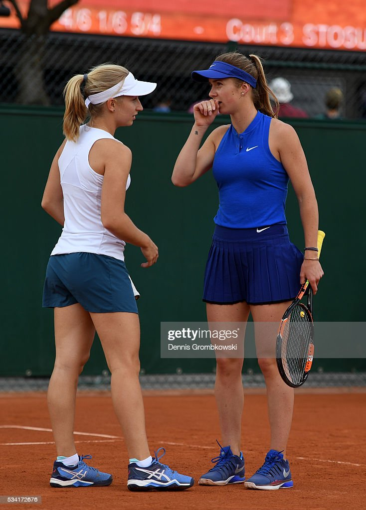 Daria Gavriolva of Australia talks with Elina Svitolina of Ukraine during the Women's Double first round match against Gabriela Dabrowski of Canada and Maria Jose Martinez Sanchez of Spain on day four of the 2016 French Open at Roland Garros on May 25, 2016 in Paris, France.