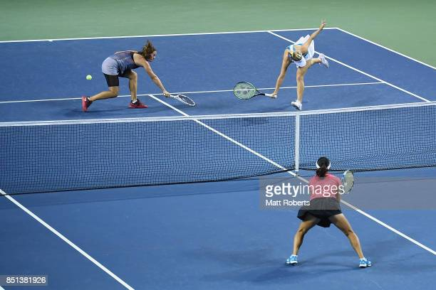 Daria Kasatkina of Russia and Daria Gavrilova of Australia compete for the ball in their doubles semi final match against Makoto Ninomiya of Japan...
