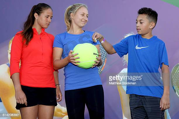 Daria Kasatkina of Russia and Daria Gavrilova of Russia are aided by Brodie YoungSmith of Great Britain with conducting the women's draw during the...