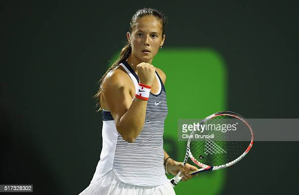 Daria Kasatkina of Russia celebrates a point against Simona Halep of Romania in their second round match during the Miami Open Presented by Itau at...
