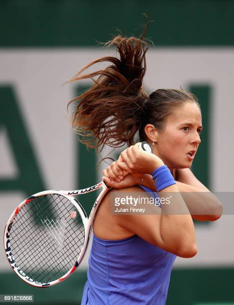 Daria Kasatkina of Russia plays a backhand during the ladies singles third round match against Simona Halep of Romania on day seven of the 2017...