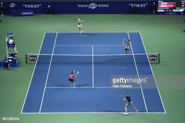 Daria Kasatkina of Russia plays an overhead volley with partner Daria Gavrilova of Australia in their doubles semi final match against Makoto...