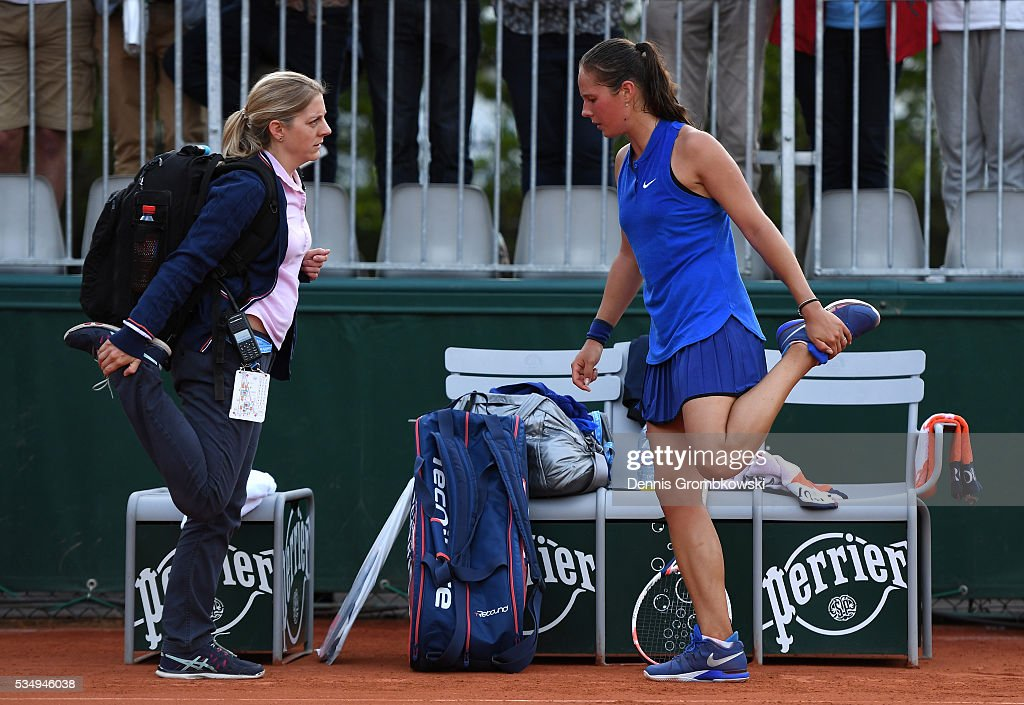 <a gi-track='captionPersonalityLinkClicked' href=/galleries/search?phrase=Daria+Kasatkina&family=editorial&specificpeople=10965238 ng-click='$event.stopPropagation()'>Daria Kasatkina</a> of Russia recaives treatment during the Ladies Singles third round match against Kiki Bertens of Netherlands on day seven of the 2016 French Open at Roland Garros on May 28, 2016 in Paris, France.