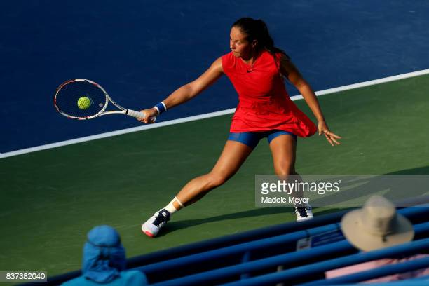 Daria Kasatkina of Russia returns a shot to Elise Mertens of Belgium during Day 5 of the Connecticut Open at Connecticut Tennis Center at Yale on...