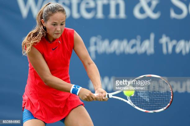 Daria Kasatkina of Russia returns a shot to Madison Keys during day 5 of the Western Southern Open at the Lindner Family Tennis Center on August 16...