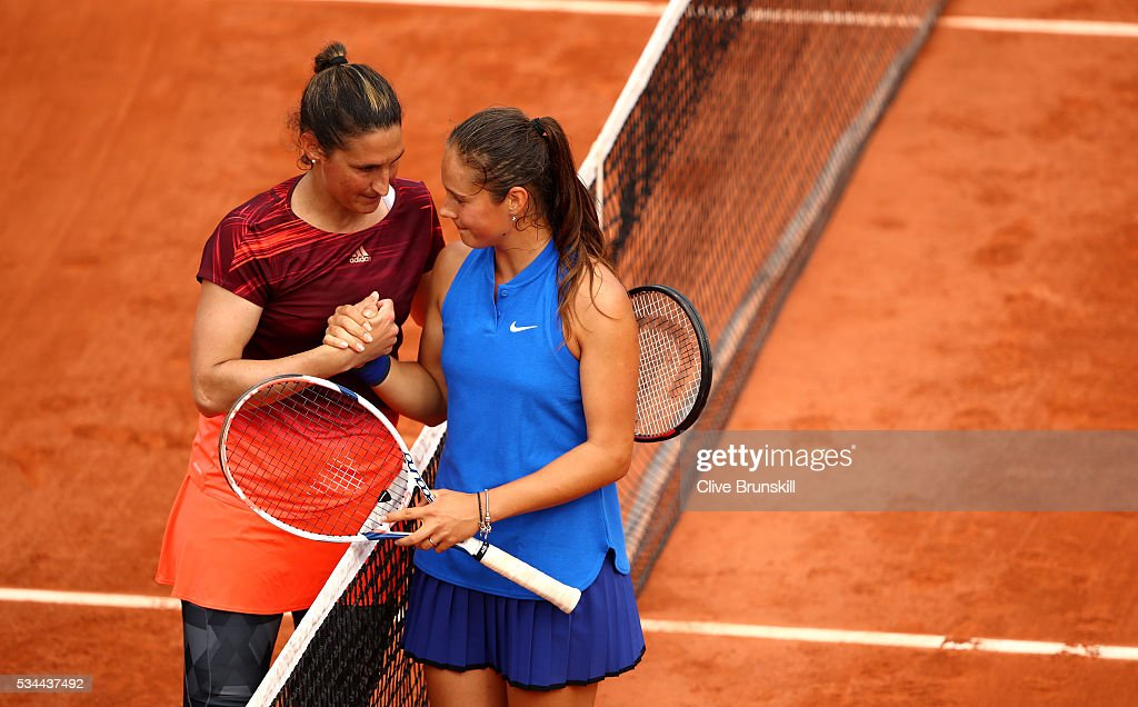 <a gi-track='captionPersonalityLinkClicked' href=/galleries/search?phrase=Daria+Kasatkina&family=editorial&specificpeople=10965238 ng-click='$event.stopPropagation()'>Daria Kasatkina</a> (R) of Russia shakes hands with Virginie Razzaro of France following her victory during the Ladies Singles second round match against on day five of the 2016 French Open at Roland Garros on May 26, 2016 in Paris, France.
