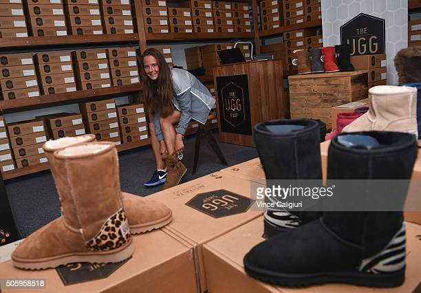 Daria Kasatkina of Russia trying ugg boots on at the Australia pop up shop during day four of the 2016 Australian Open at Melbourne Park on January...