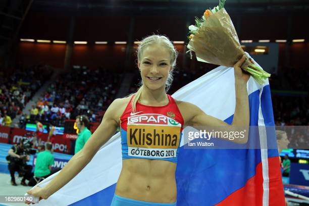 Daria Klishina of Russia celebrates winning gold in the Women's Long Jump Final during day two of the European Athletics Indoor Championships at...