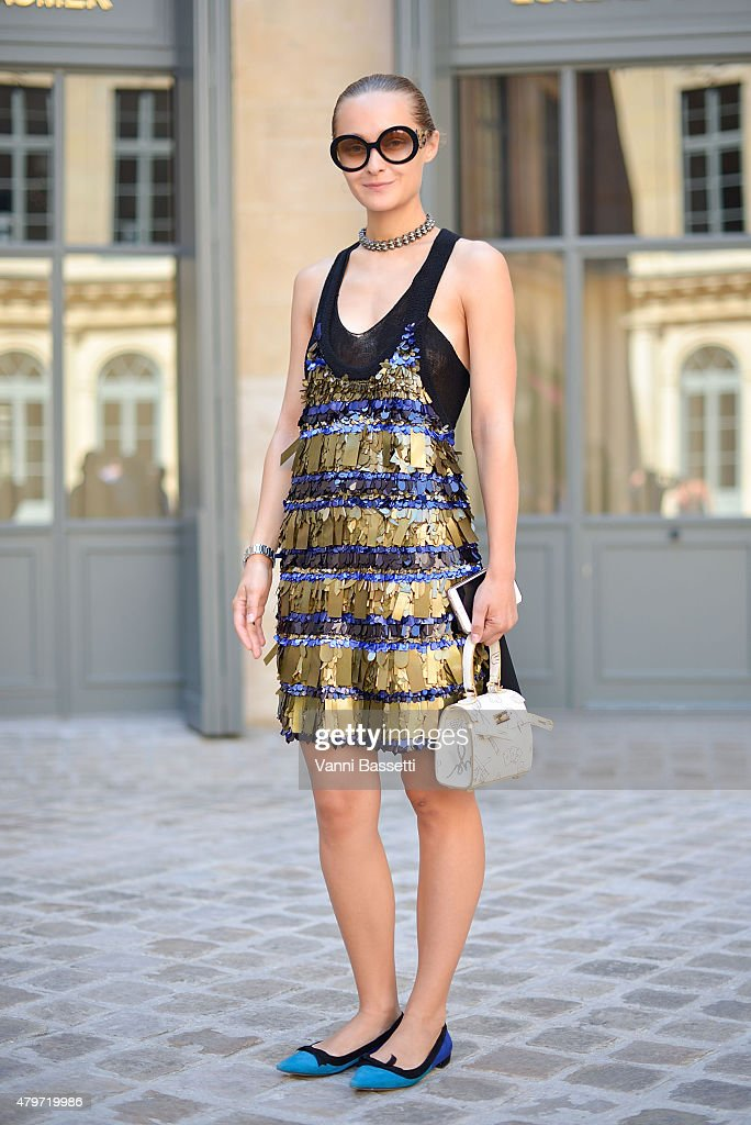 Daria Shapovalova poses wearing a Sonia Rykiel dress before the Schiapparelli show at Place Vendome on July 6 2015 in Paris France