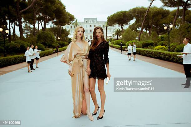 Daria Strokous and Alina Baikova attend amfAR's 21st Cinema Against AIDS Gala presented by WORLDVIEW BOLD FILMS and BVLGARI at Hotel du CapEdenRoc on...