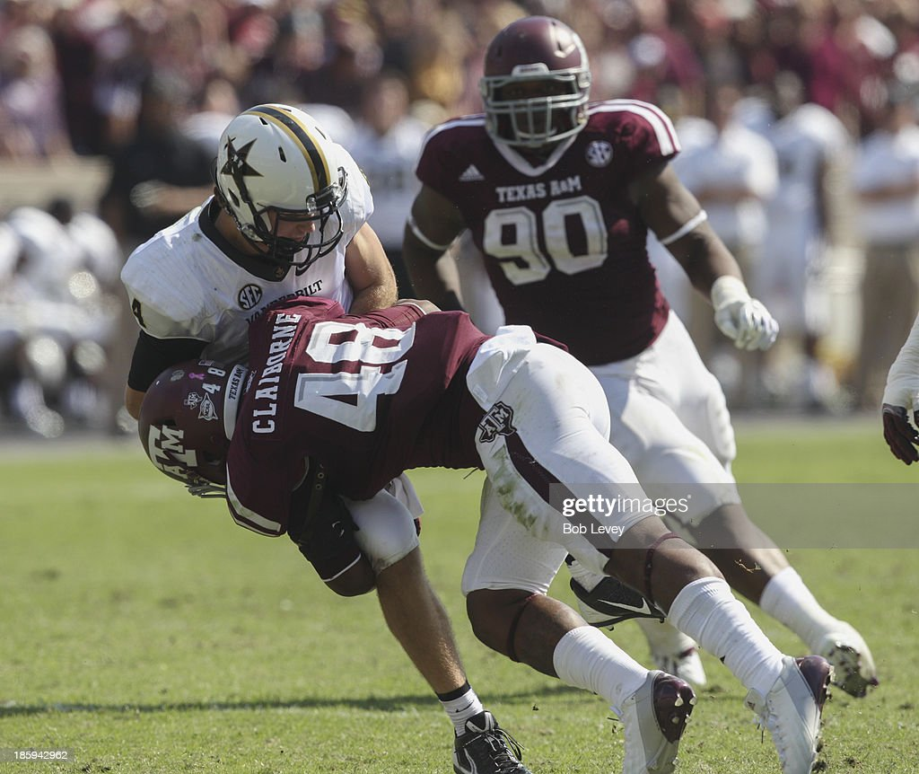 Darian Claiborne #48 of the Texas A&M Aggies lays a hard hit on Patton Robinette #4 of the Vanderbilt Commodores at Kyle Field on October 26, 2013 in College Station, Texas.